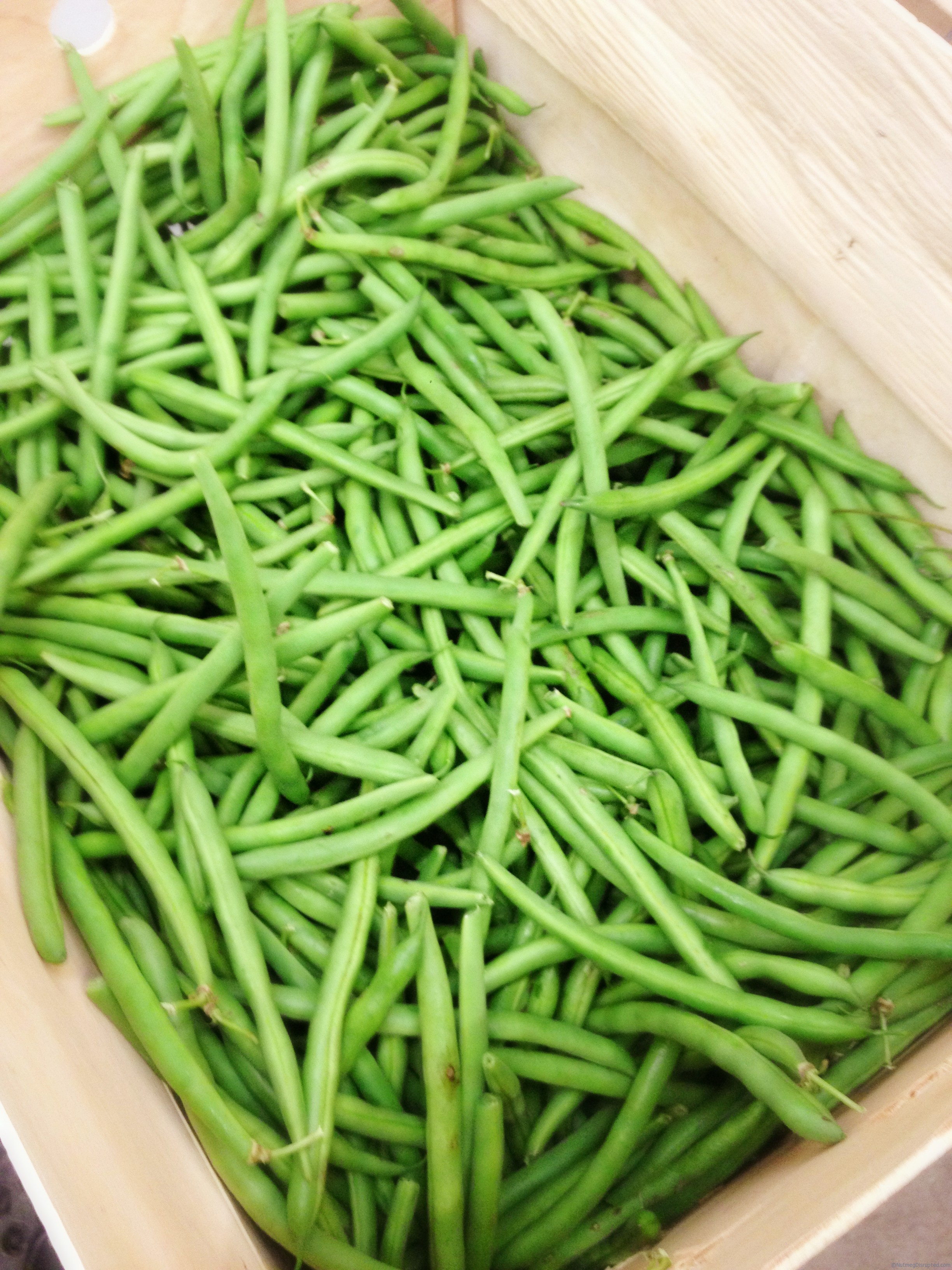 Crates of fresh green beans in the Nutmeg Disrupted kitchen